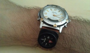 Arjen's right wrist with compass on watch band